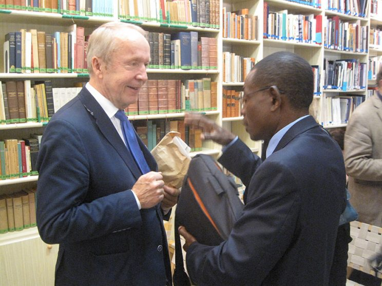 Prof. Jean-Claude Mbarga hands over the prospectus of a cultural academy in Africa